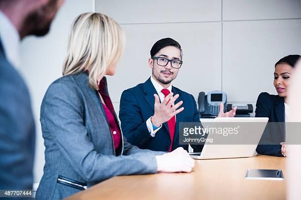 Smart businessman talking in business meeting