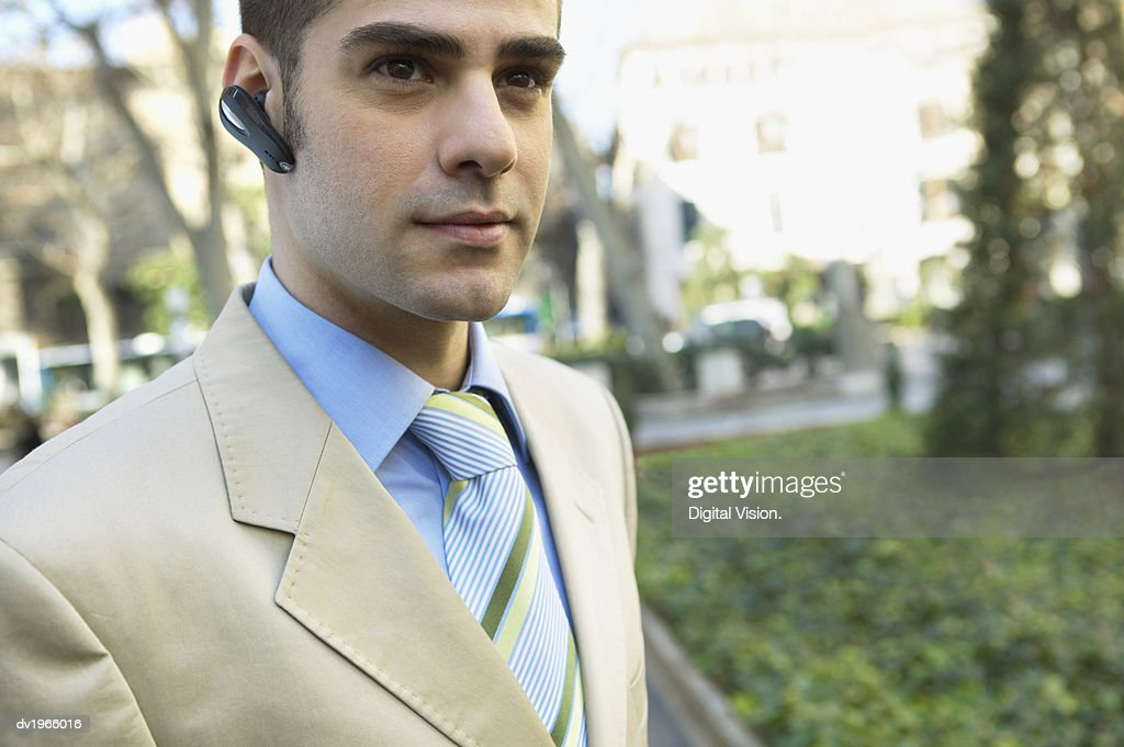 Smart Businessman Wearing a Hands-Free Device : Stock Photo