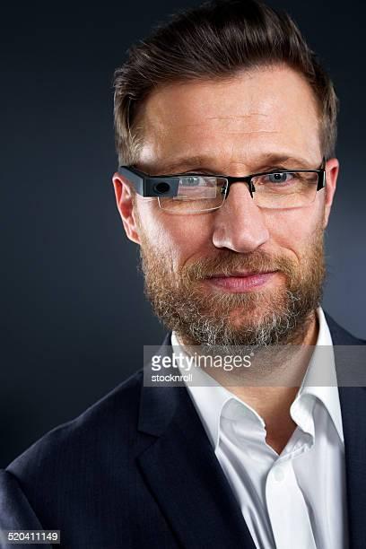 Smart businessman wearing futuristic glasses