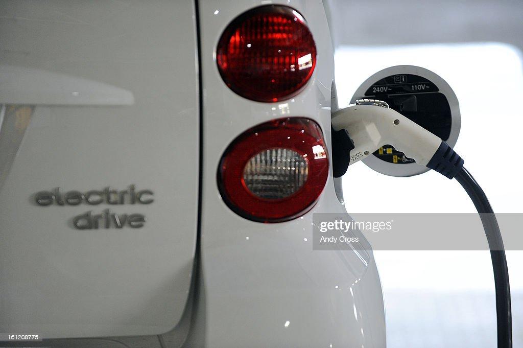 Smart Car electric car gets charged up at the u0027Juice Baru0027 station inside & DENVER CO-- A Smart Car electric car gets charged up at the ...