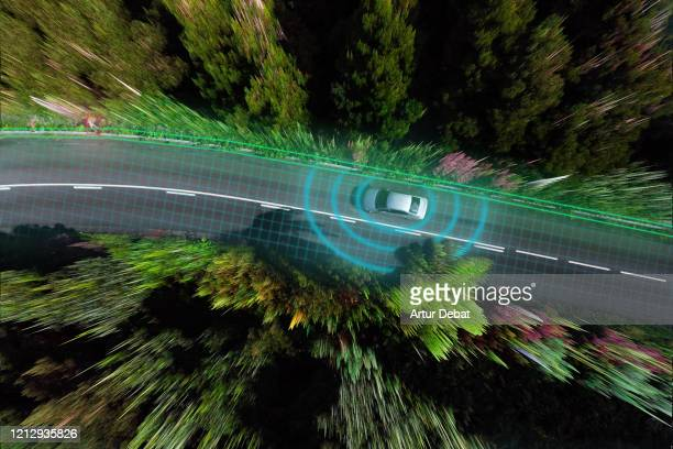smart car evaluating the road with sensors and futuristic technology. - autonomous technology stock pictures, royalty-free photos & images