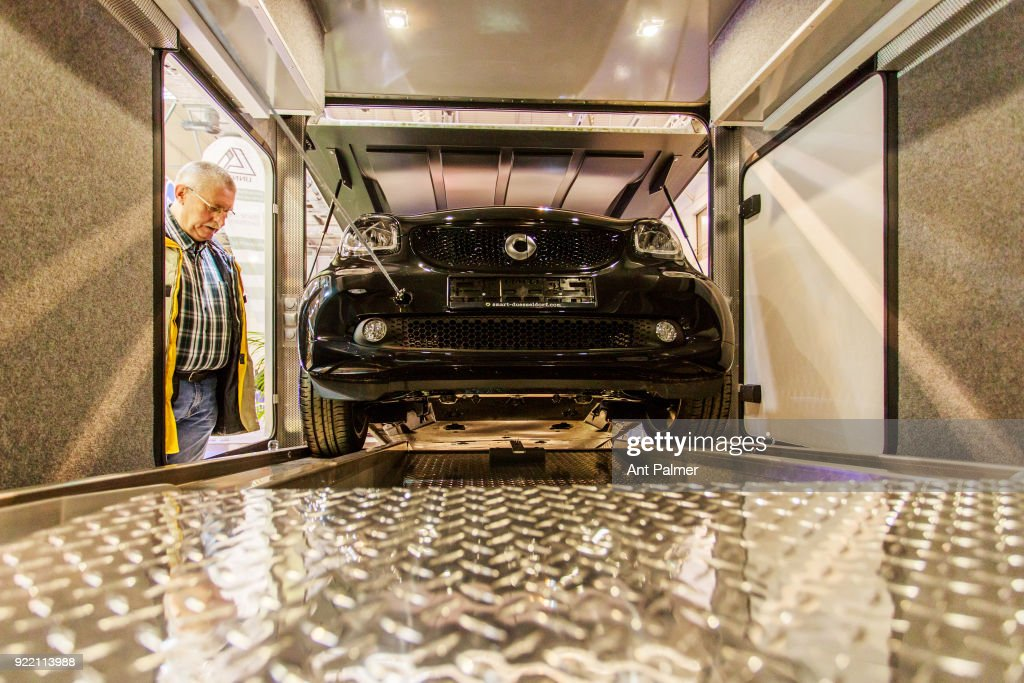A Smart car is demonstrated being winched into the rear compartment of a motorhome at the Reise + Camping Exhibition on February 21, 2018 in Essen, Germany. The annual event features over 1000 exhibitors from over 20 countries.