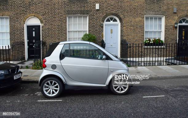 A 'smart' car is parked in front of a home in the exclusive Belgravia district in London England Smart Automobile is a German automotive marque and...