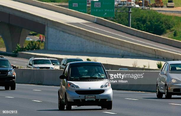 Smart Car travels over the Woodrow Wilson Bridge on September 4, 2009 in National Harbor, Maryland. The American Automobile Association is projecting...