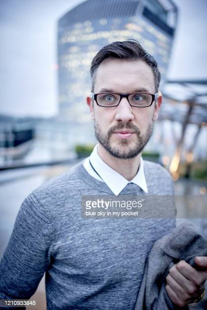 a smart casual business man wearing eyeglasses outside in the rain - handsome muscle men stock pictures, royalty-free photos & images