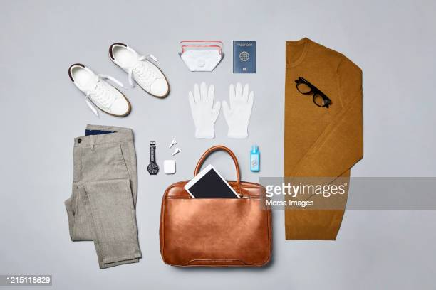 smart casual with technologies and accessories accessories against covid-19 - travel stock pictures, royalty-free photos & images