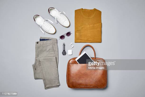 smart casual with technologies and accessories - men fashion stock pictures, royalty-free photos & images