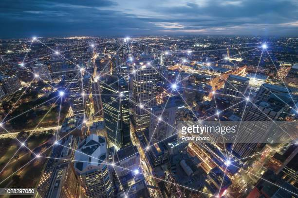 smart city and connection lines. internet concept of global business in sydney, australia. - network stock pictures, royalty-free photos & images