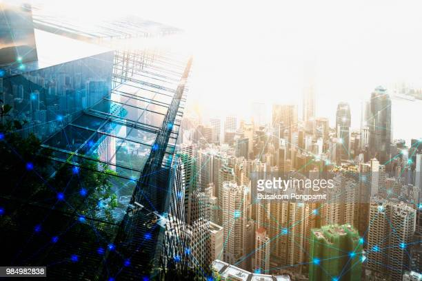 smart city and network -  connection on city building background, technology concept. - building icon stock photos and pictures