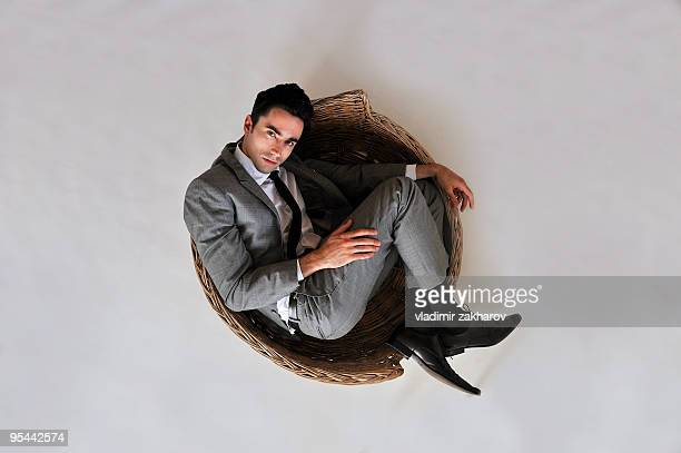 Smart dressed man in dog basket