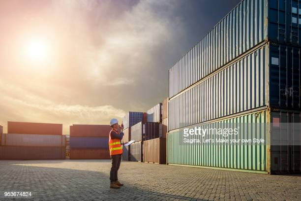 smart engineer foreman control loading containers box from cargo freight ship for import export. business logistic and transportation concept - container stock pictures, royalty-free photos & images