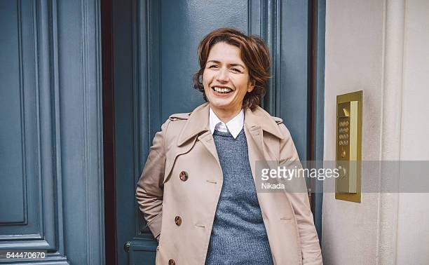 smart fashionable woman stepping outdoors - french culture stock pictures, royalty-free photos & images