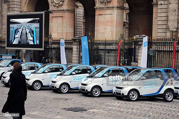 Smart fortwo coupe pure car2go edition with a Solar roof are parked in front of Lyon's city hall on February 1 during the presentation and launching...