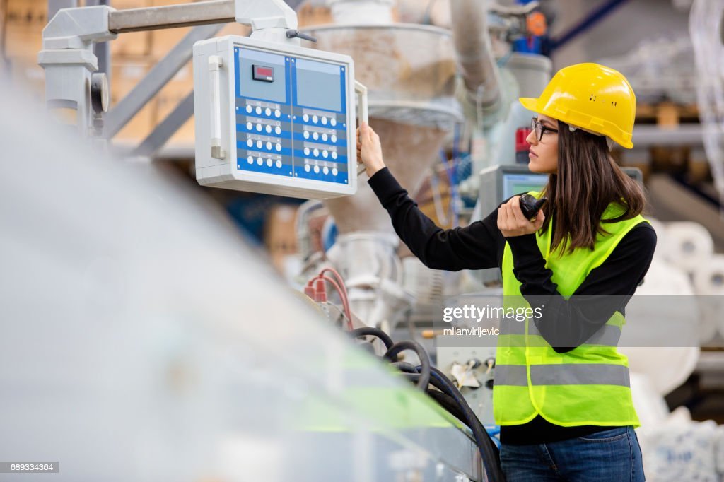 Smart girl beautful woman controls machines : Stock Photo