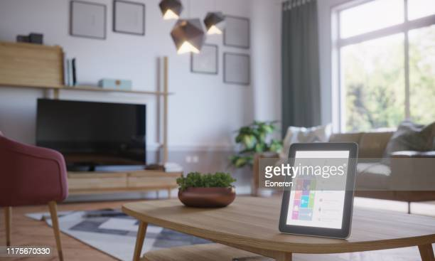 smart home control in scandinavian home interior - smart stock pictures, royalty-free photos & images