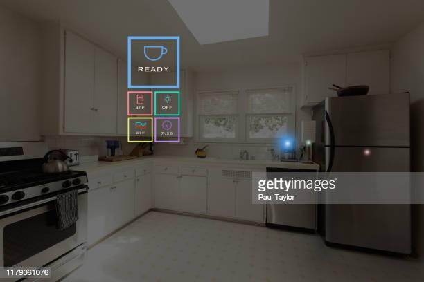 smart home control kitchen - internet delle cose foto e immagini stock