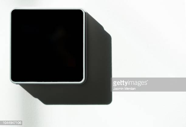 Smart house display on wall in living room