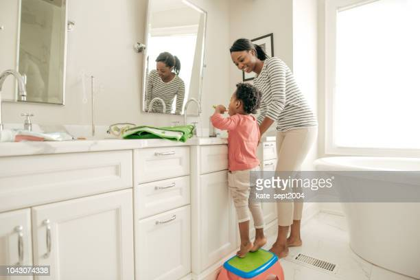 smart investment - brushing teeth stock pictures, royalty-free photos & images