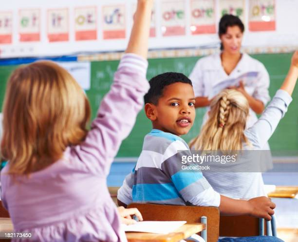 Smart little African American school boy smiling