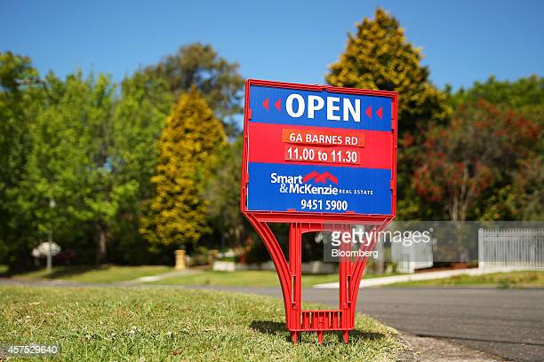 A Smart McKenzie Real Estate open house sign stands on display on a street in the suburb of Frenchs Forest Sydney in Australia on Saturday Oct 18...