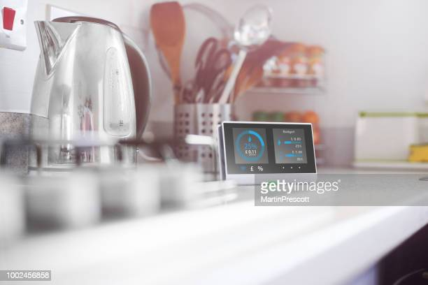 smart meter in the kitchen - fuel and power generation stock pictures, royalty-free photos & images