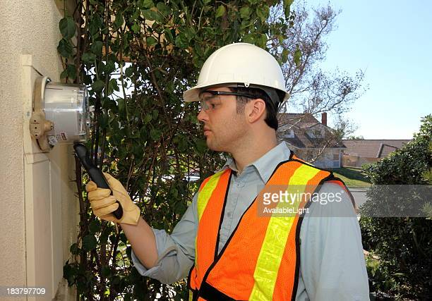 Smart Meter Technician Calibrates Device