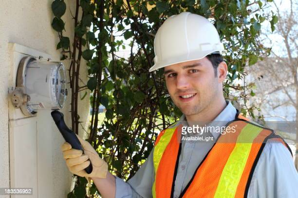 Smart Meter Technician Callibrates Device Horizontal