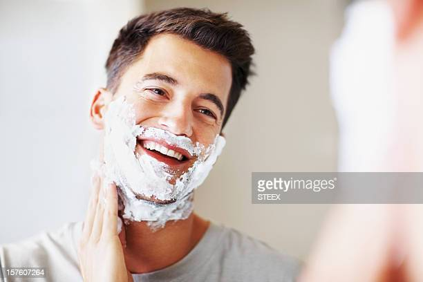 smart middle aged man applying shaving cream - shaving stock pictures, royalty-free photos & images