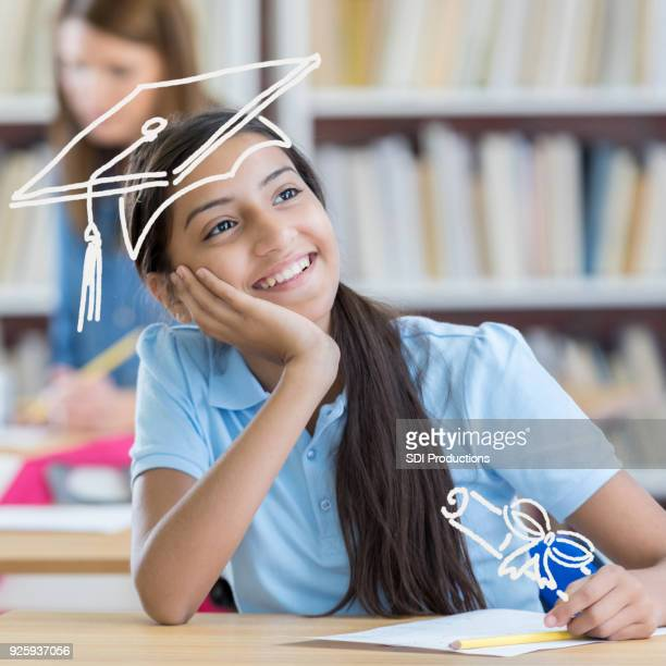 smart middle school student dreams of graduating - budding tween stock photos and pictures