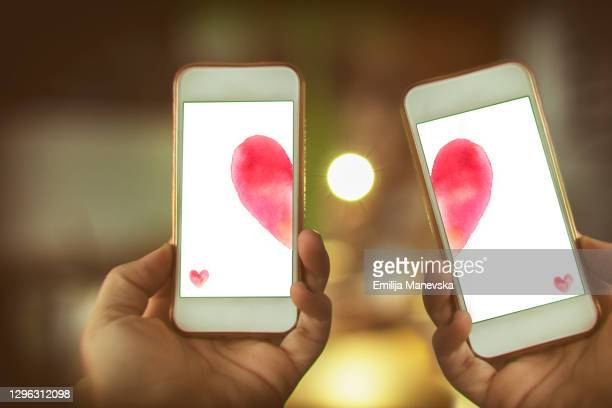 smart phone love connection - romance stock pictures, royalty-free photos & images