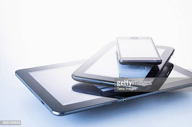Smart phone lying on digital tablets