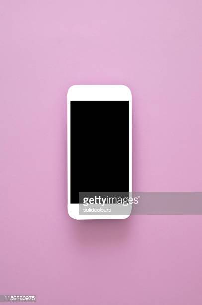 smart phone on pink - website template stock photos and pictures