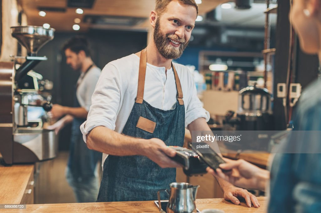 Smart phone payment in the coffee shop : Stock Photo