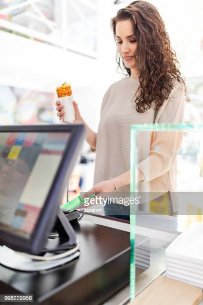 smart phone payment - convenience stock photos and pictures