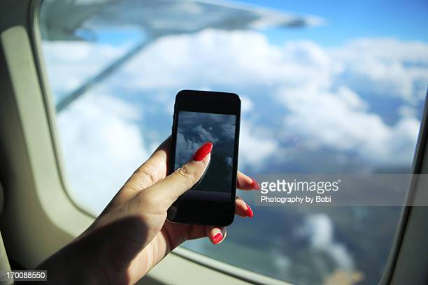 Smart phone takeing pictrues on the plane