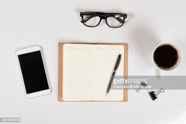Smart phone white background simple office desk top view