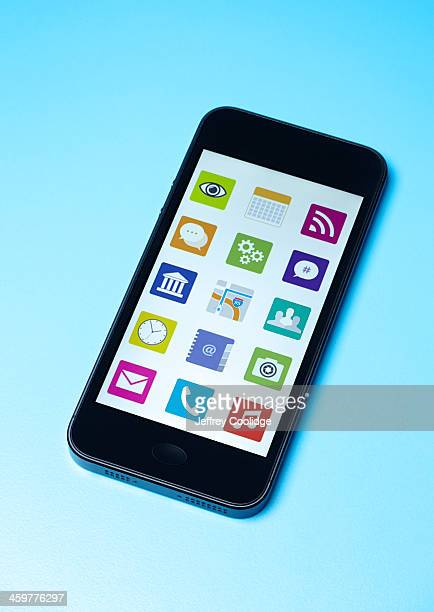 smart phone with icons - phone icon stock pictures, royalty-free photos & images
