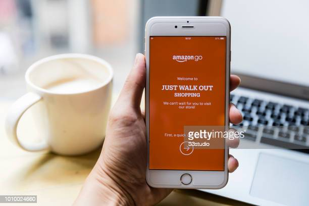A smart phone with the Amazon apps Amazon Go is seen on the screen in Hong Kong Hong Kong on August 03 2018