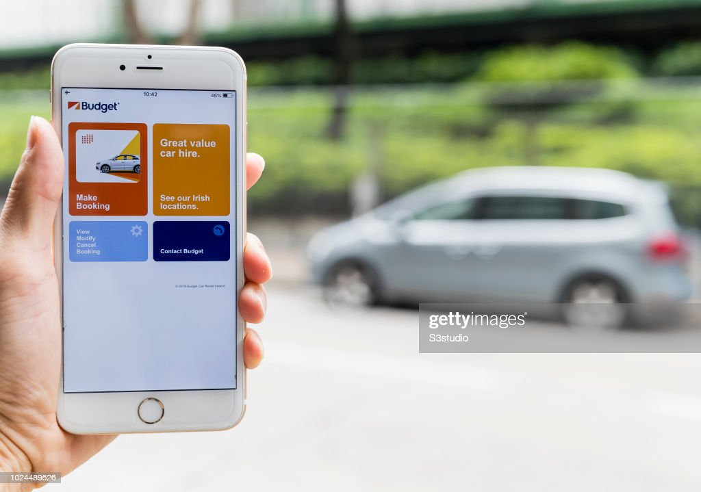 A smart phone with the car rental app Budget Rent a Car is