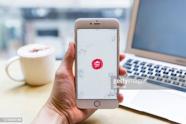 A smart phone with the fast food app Pizza Hut is seen on the screen in Hong Kong Hong Kong on July 31 2018
