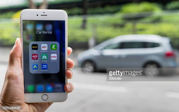 Smart phone with the icons for the car rental apps from Hertz, Budget Rent a Car, Europcar, Avis Rent a Car, Enterprise Rent-A-Car, Dollar Rent A...