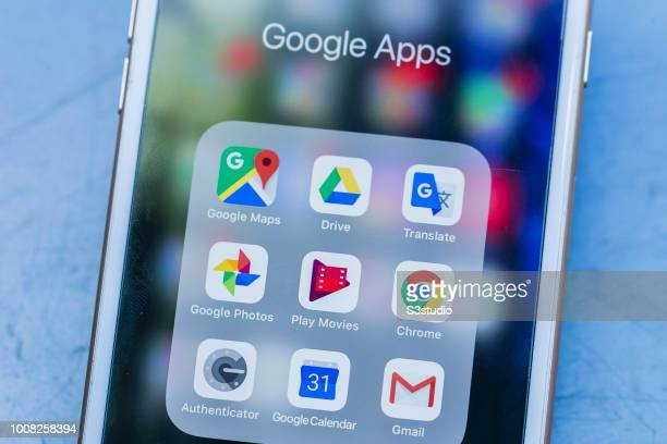 A smart phone with the icons for the Google apps from Google Map Google Drive Google Translate Google Photo Google Play Google Chrome Google...