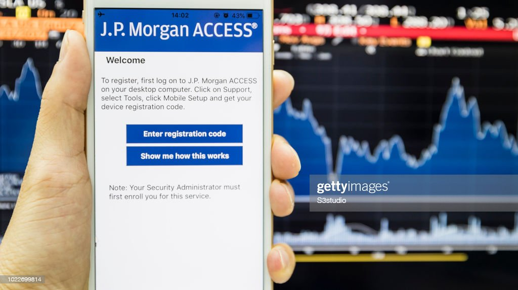 A smart phone with the J P  Morgan app is seen on the screen