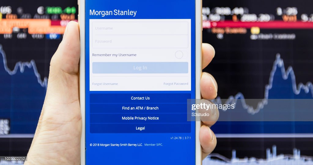 A smart phone with the Morgan Stanley app is seen on the screen in