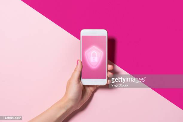 smart phone with the security key lock icon - data privacy stock pictures, royalty-free photos & images