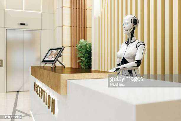 smart robot assistant on reception - artificial intelligence stock pictures, royalty-free photos & images