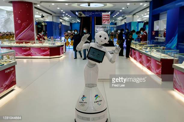 Smart robot at the Beijing 2022 licensed product flagship store greets the customers on February 8, 2021 in Beijing, China.