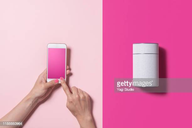 smart speaker and smart phone - cylinder stock pictures, royalty-free photos & images