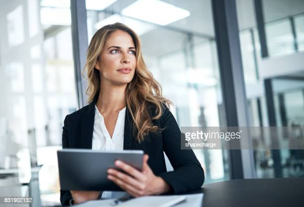 smart tech for a smart businesswoman - businesswoman stock pictures, royalty-free photos & images