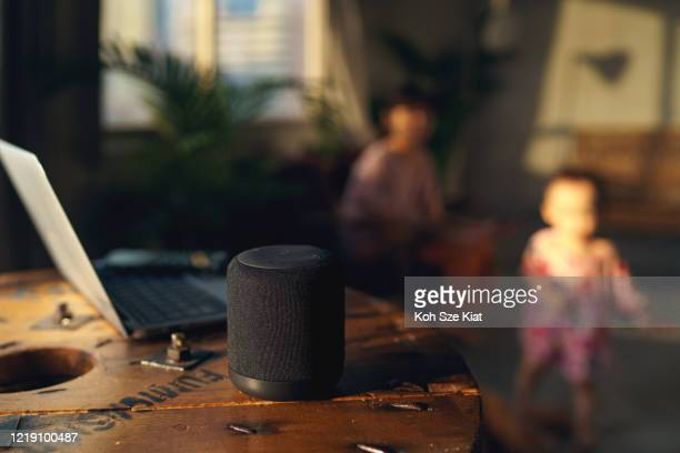 smart technology - having a smart speaker in an asian family home - bluetooth stock pictures, royalty-free photos & images